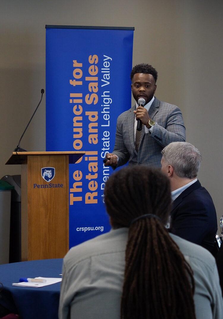 Speaker at symposium